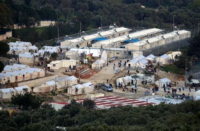 Lesbos Moria (Photo Credit: AFP/Stringer/albawaba, https://www.albawaba.com/news/msf-criticizes-eu-leaders-after-three-more-deaths-greece%E2%80%99s-moria-refugee-camp-931790)