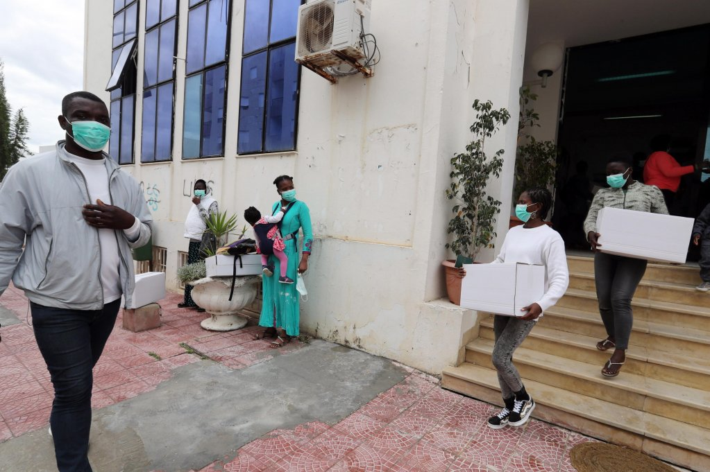 Migrants Carrying Aid Boxes Distributed at the Raoued Town Hall in Tunis, (Mohamed Messara, EPA,