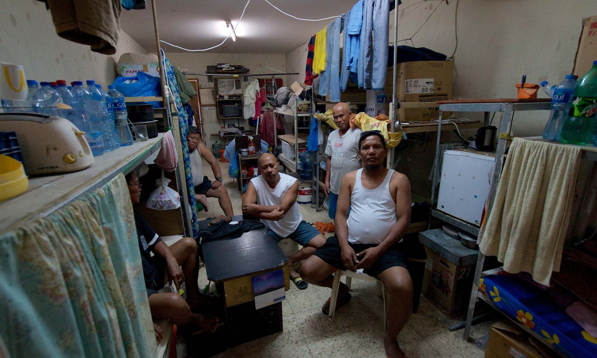 Pete Pattisson, Dormitory of Migrant Workers Living in the Industrial Area Outside Doha, (https://www.theguardian.com/global-development/2020/mar/20/covid-19-lockdown-turns-qatars-largest-migrant-camp-into-virtual-prison)