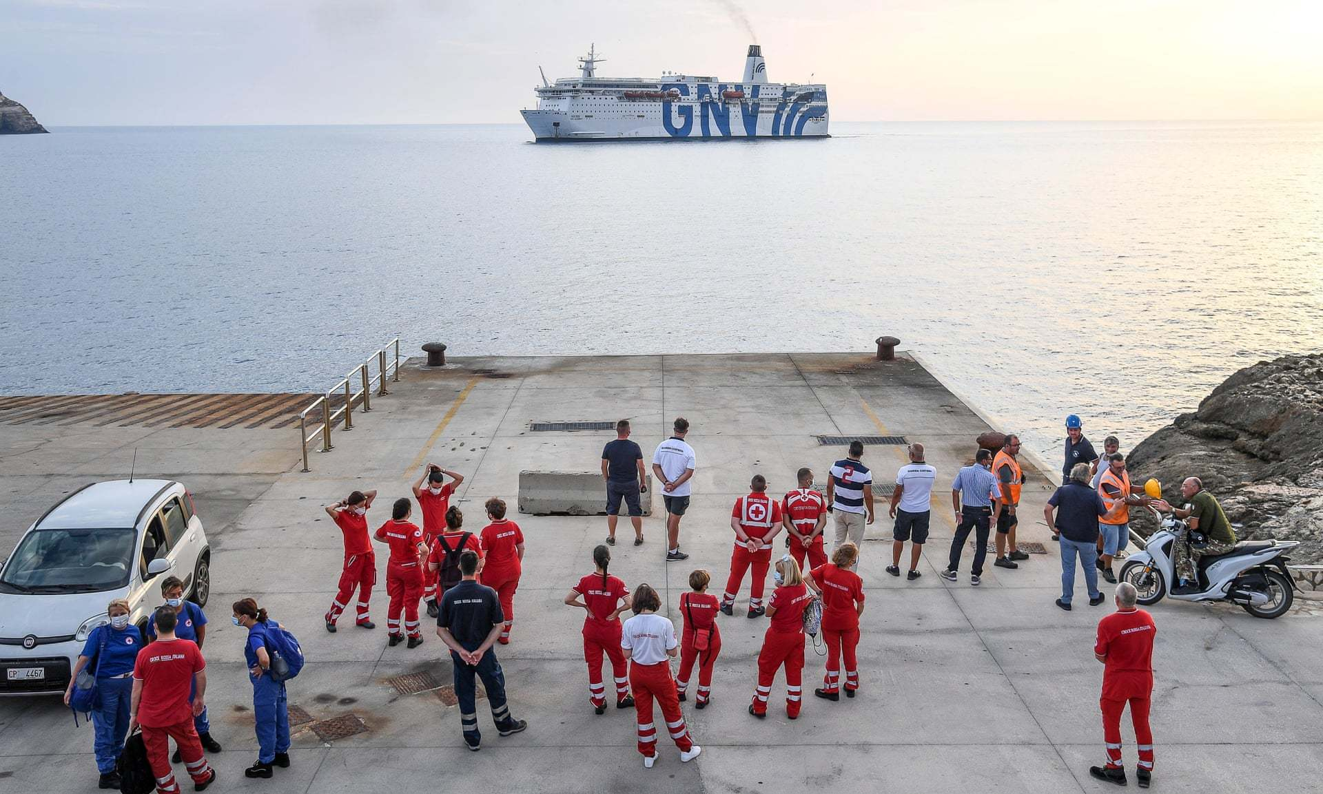 Members of the Italian Red Cross Gather on Quay as a Quarantine Ship Heads Towards Lampedusa Island, (Alessandro Di Meo, EPA,