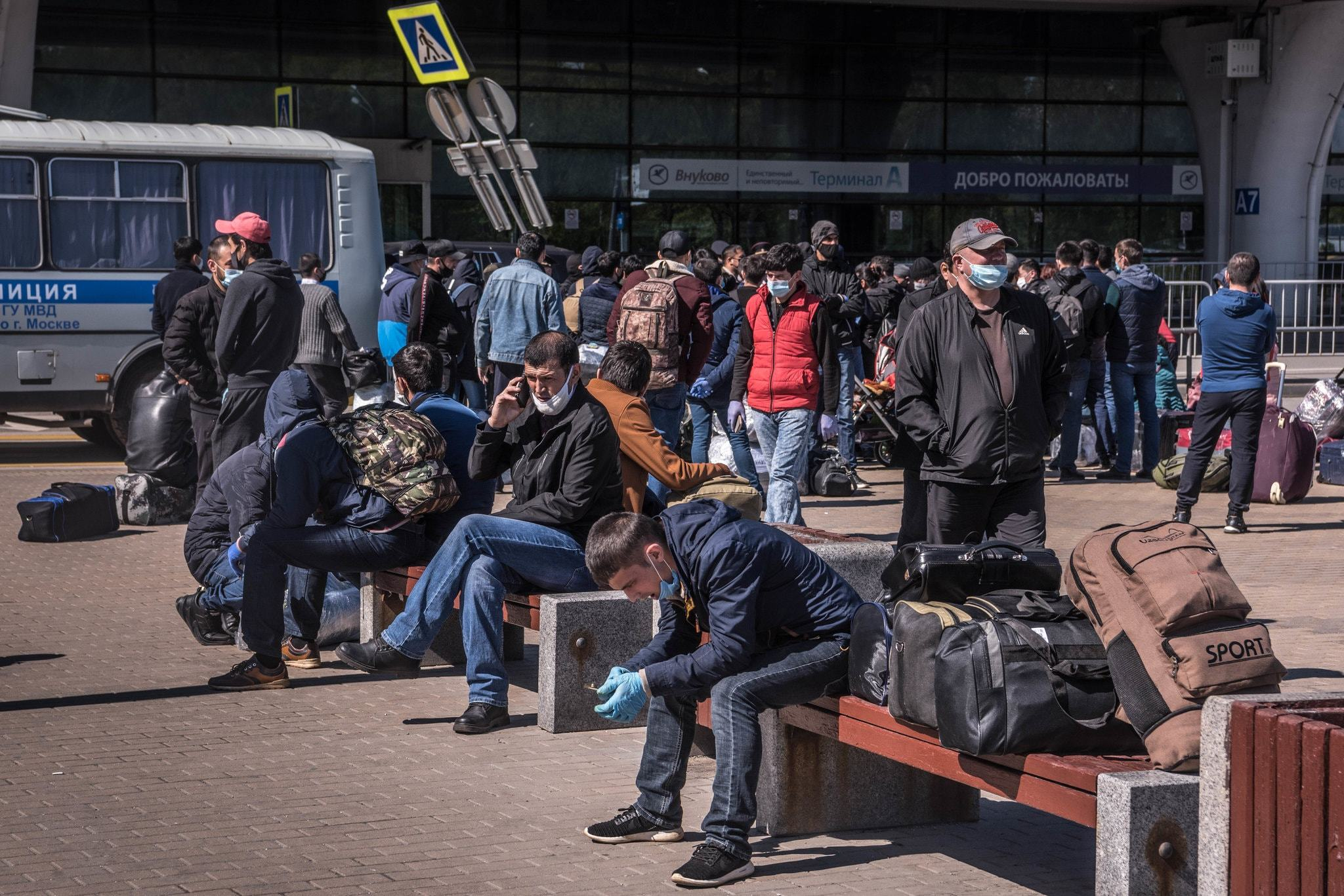 Uzbek Nationals Waiting Outside Vnukovo International Airport in Moscow Hoping to Buy Tickets for an Evacuation Flight, (Sergey Ponomarev,
