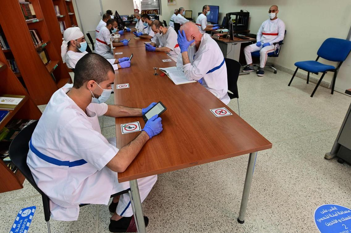 Prisoners Reading inside the Dubai's Central Prison Library, (Giuseppe Cacace, AFP,
