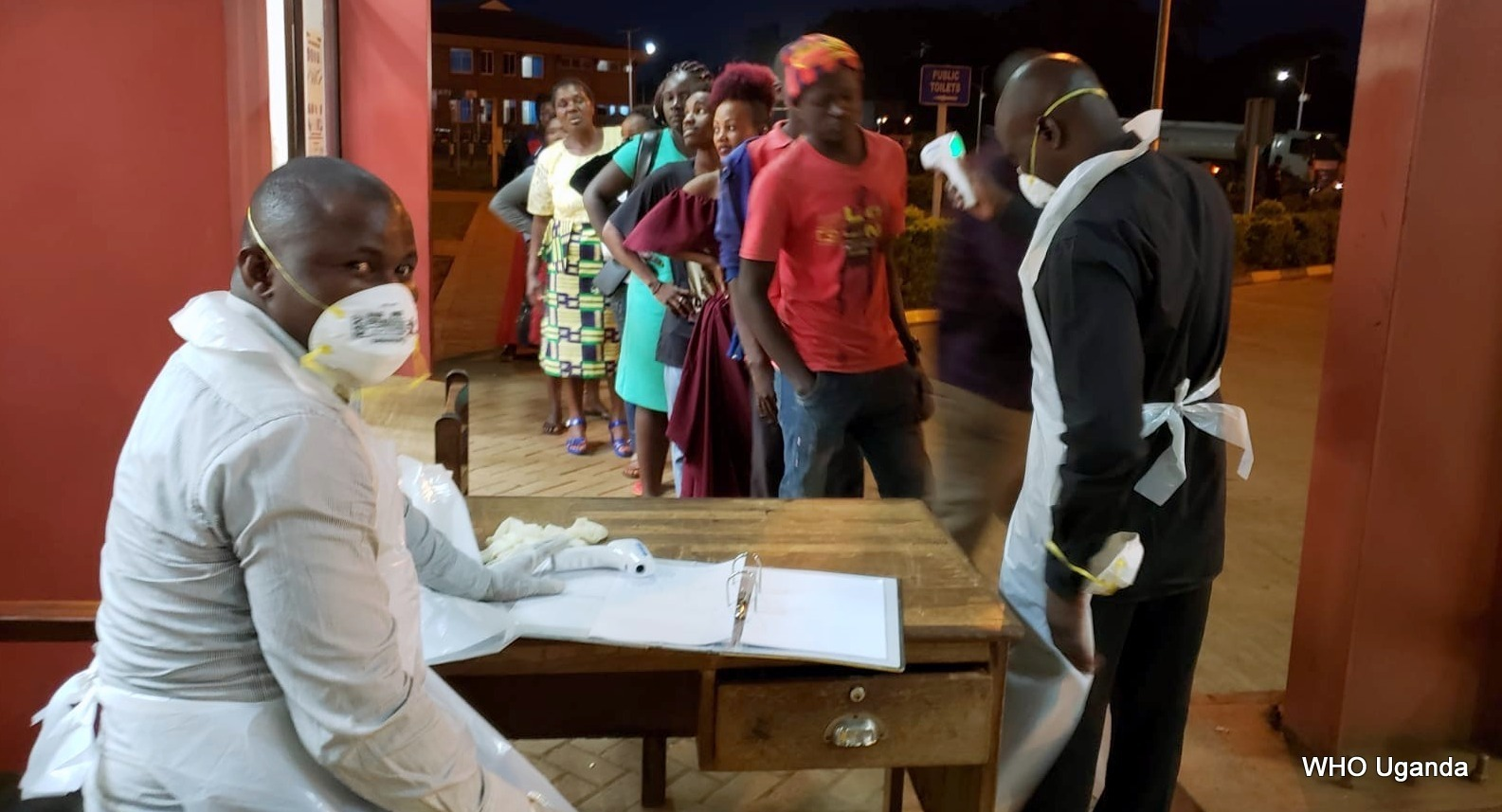 Health workers screen arrivals for Covid-19 (https://www.afro.who.int/news/uganda-uses-recent-outbreak-experience-prepare-coronavirus)