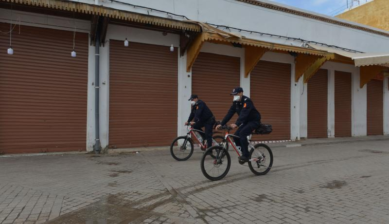 "Two Police Officers Riding Bikes in Front of Shut Stores, (J. Morchidi, Getty Images, Dr. M. Masbah, ""Can Morocco Effectively Handle the Covid-19 Crisis?"" Chatham House, 6 April 2020, https://www.chathamhouse.org/expert/comment/can-morocco-effectively-handle-covid-19-crisis-1#)"
