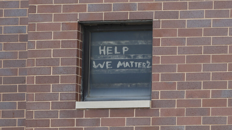 The Words 'Help We Matter 2' Are Seen on a Window at the Cook County Department of Corrections in April 2020, (K. Krzaczynski, Getty Images,