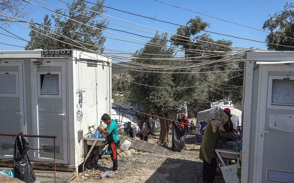 "Sanitary Facilities at the Moria Camp, (T. Georgiopoulou, ""Concern After First Covid Case at Moria Migrant Camp,"" Ekathimerini, 3 September 2020, https://www.ekathimerini.com/256512/article/ekathimerini/news/concern-after-first-covid-case-at-moriamigrant-camp)"