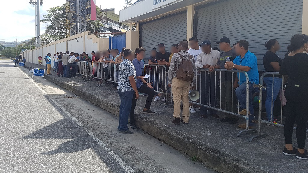 Migrants and Asylum Seekers Waiting to be Registered During the Two Week Registration Period in T&T in 2019, (Looptt,
