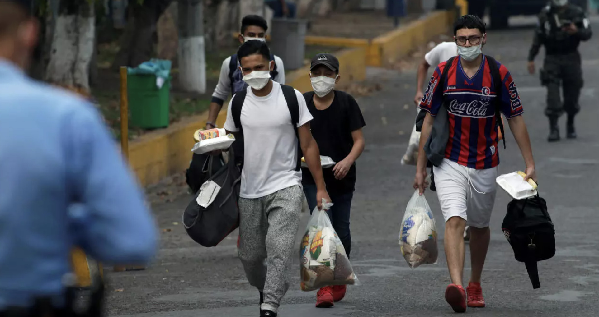 Migrants Coming Out of the Temporary Quarantine Centre in Tegucigalpa after having Been Deported From Mexico, (Jorge Cabrera, Reuters,