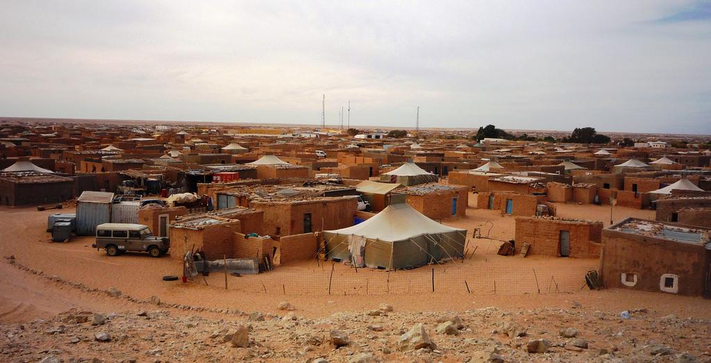 """A Sahrawi Refugee Camp near Tindouf, (European Commission DG ECHO, Flickr, """"La Patience des Sahraouis,"""" Asile.ch, 12 February 2016, https://asile.ch/2016/02/12/rtn-la-patience-des-sahraouis/)"""