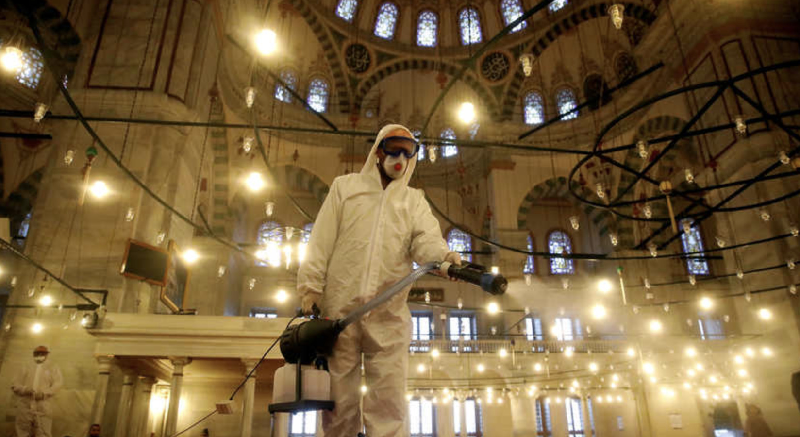 A worker in protective clothing disinfects the Fatih Mosque in Istanbul, 14 March 2020 (https://www.al-monitor.com/pulse/originals/2020/03/turkey-coronavirus-spread-case-triple.html)