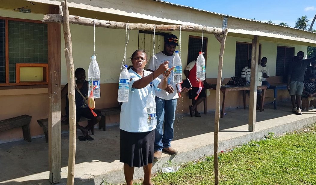 Voters Washing Their Hands Before Casting Ballots in a Polling Station on Malekula Island on 19 March 2020, (The MSG Secretariat,