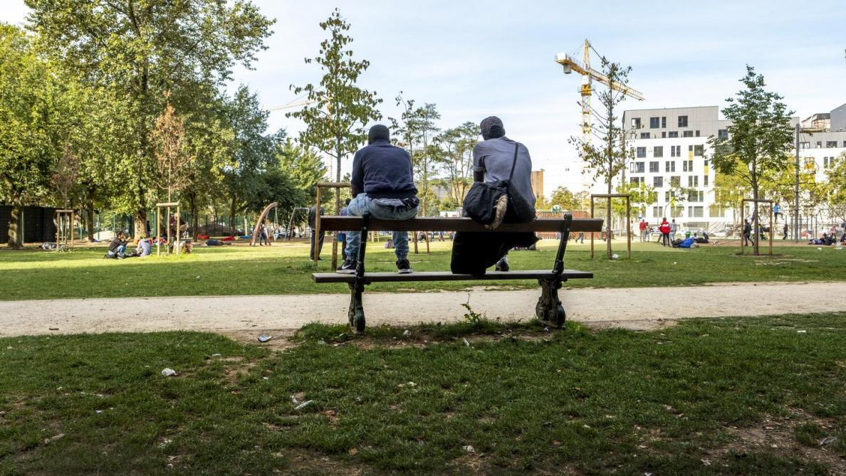 Migrants Left Homeless Sitting on a Bench in a Park in Brussels, (Olivier Polet, 20 March 2020, Le Soir,