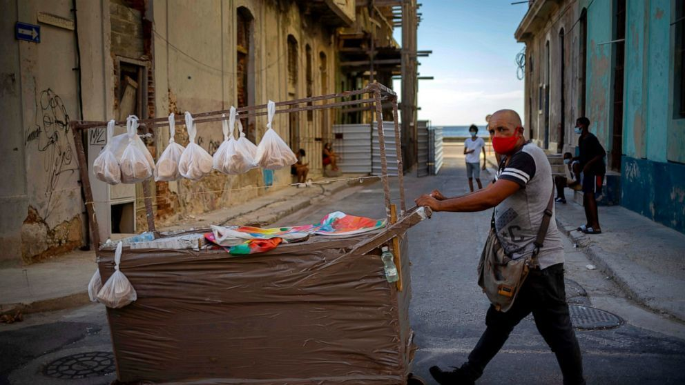 A Street Vendor Wearing a Mask as a Precaution Against the Spread of Coronavirus, (Associated Press,