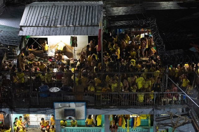 Prisoners in the Quezon City Jail Seen From Above, (Maria Tan, AFP,