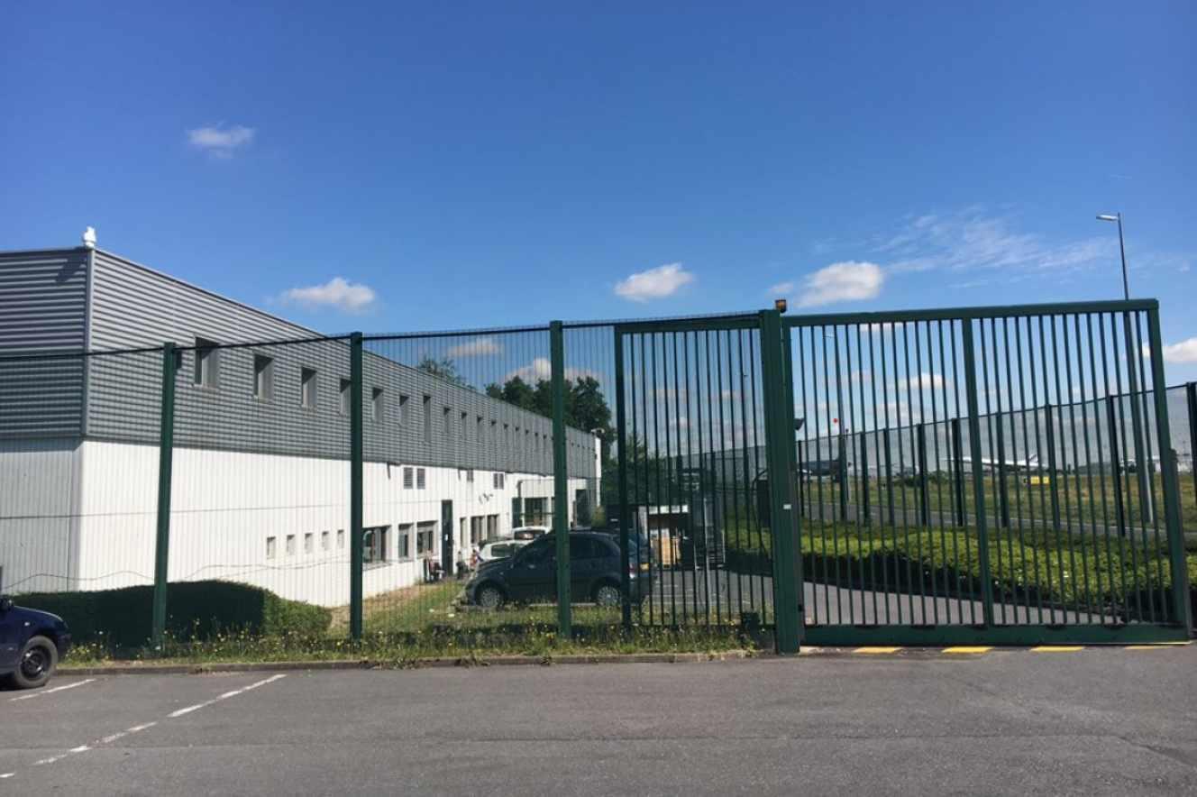 Outside View of the Zone d'Attente pour les Personnes Maintenues en Instance (ZAPI), (C. Bouanchaud,