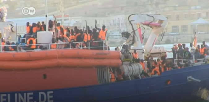 Mission Lifeline Boat Rescuing Refugees and Docking Into Maltese Port, (DW,