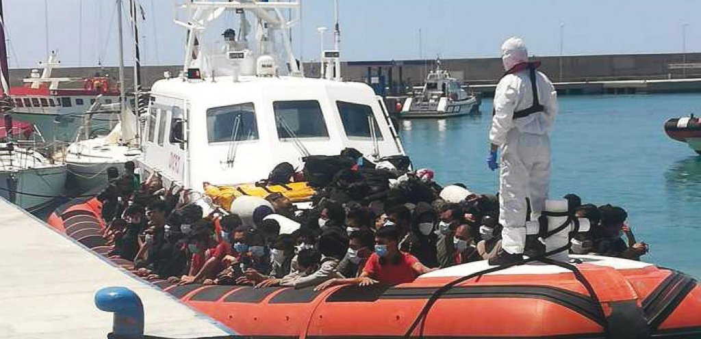 A Group of Migrants on a Boat Being Assisted with Anti-Covid Procedures During a Landing in Roccella Jonica in Calabria on 6 July 2021 (ANSA,