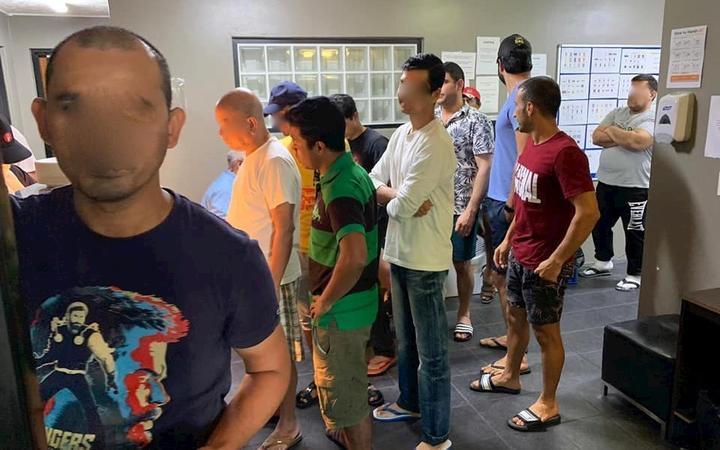 Refugees Queue for Food in Brisbane, (Hakeem Kakar,