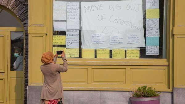 A Resident of the Skellig Star Direct Provision Centre in Cahersiveen Taking a Picture of the Front Window of the Hotel, (Alan Landers,