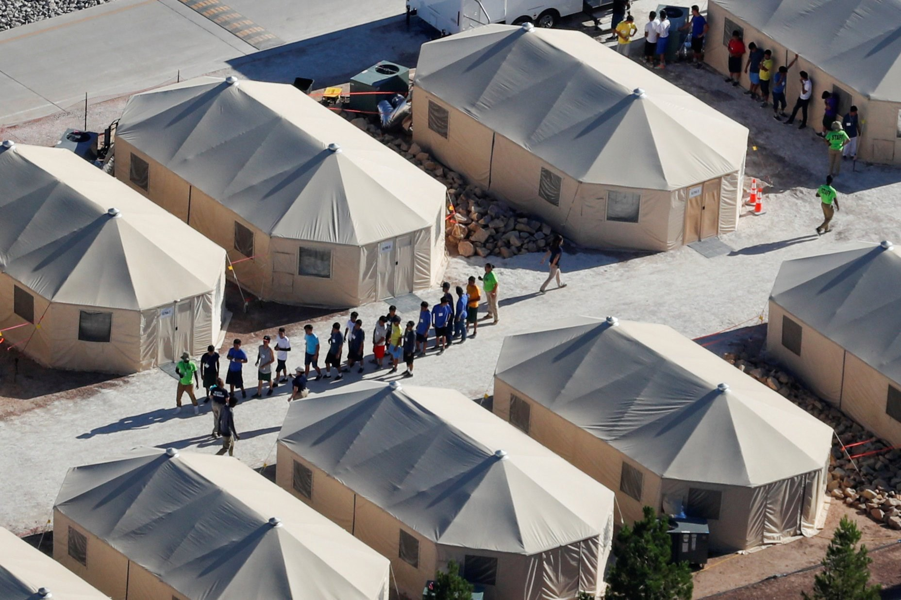 Children Walking in a line at a Tent Encampment in Tornillo, Texas, on 19 June 2018, (Mike Blake, Reuters,