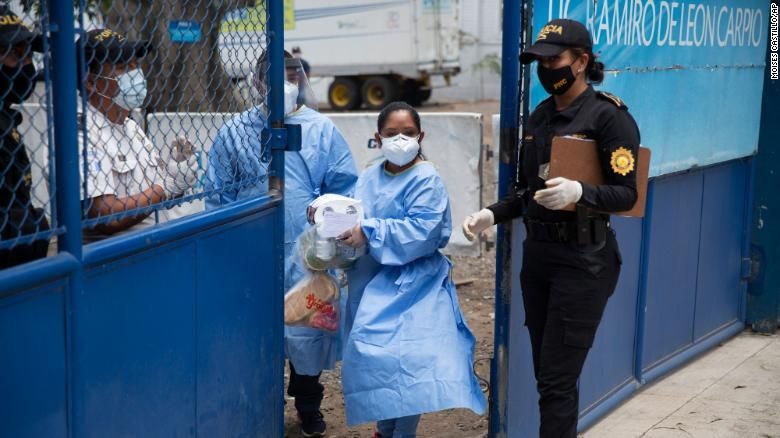 Health Workers Bringing in Supplies Deliveries by Family Members to a Temporary Shelter for Guatemalan Citizens Deported from the United States, (17 April 2020, CNN,