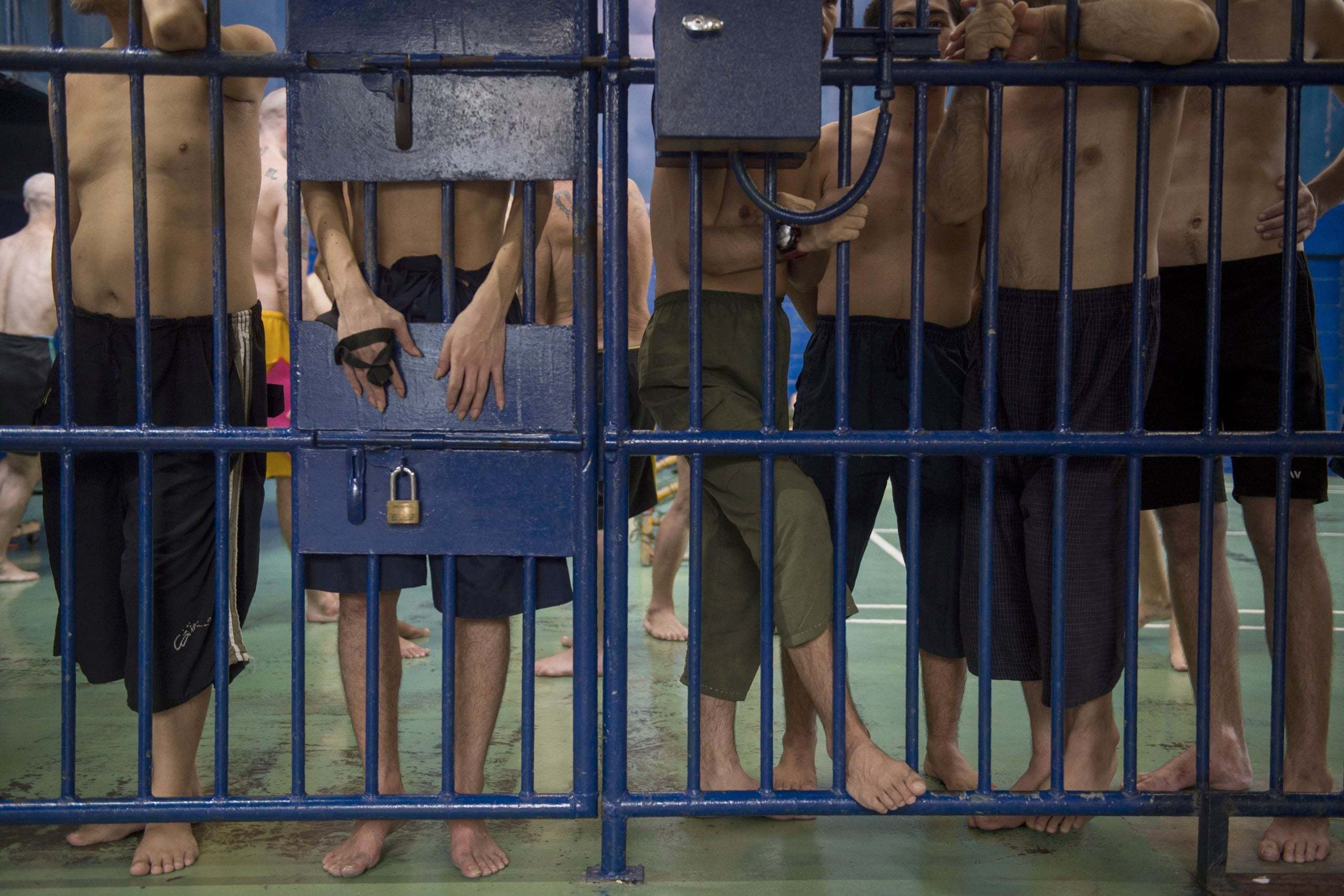 Immigration Detainees Stand Behind Bars at an Immigration Detention Centre in Bangkok, (Romeo Gacad, AFP, Getty Images,