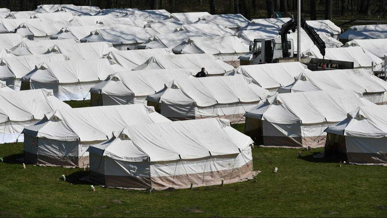 Tents in Morovic Camp - originally intended to be used for quarantining Serbian nationals returning home, but now being used to deain migrants and asylum seekers, (mod.gov.rs,