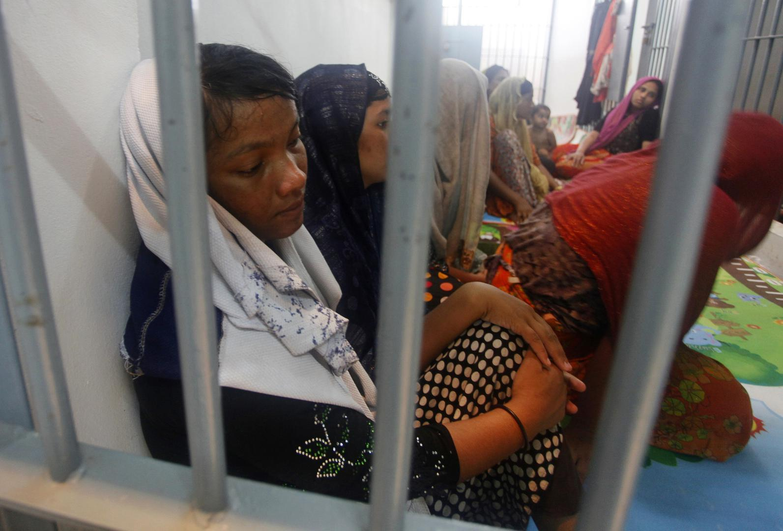 Rohingya Refugees Sit Behind Bars at a Police Station in Satun Province, Thailand, (AP Photo,